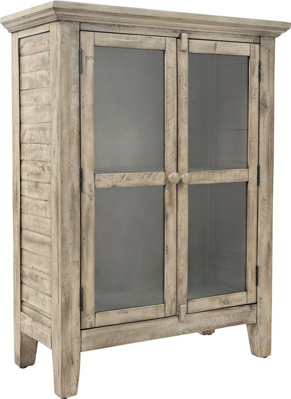 Stow serveware in the dining room or display objets d'art in the foyer with this stylish weathered cabinet, featuring a rustic finish and glass paneled drawers.