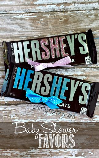 """Activity/Favor - He-She Hershey's Bar: Fun idea to use these for a gender reveal party by lining them up in different rows and having guests choose which they think the gender will be! For the words of """"HE"""", used a blue permanent marker to color in the letters then stuck a bow at the bottom. For the """"SHE"""" favor, put glue over the letters and sprinkled pink glitter."""