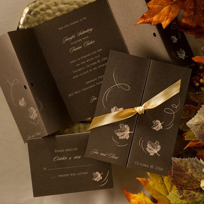 Falling leaves wedding invitations featuring a  mocha, shimmer, gate-fold invitation with a falling leaf design on the front and is tied together with the ribbon of your choice.