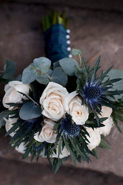 White roses, thistles and eucalyptus with tartan ribbon