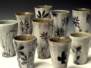 Michael Kline pottery at MudFire Gallery. Complex designs with simple glazes. Nice. Cups.