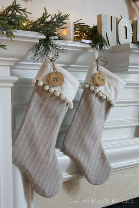 The added trim looks cute, but wooden name tags take this simple sewing project up a level. Even easier, tie on a pair of jingle bells. Click for more cute stockings to hang on your mantle this Christmas!
