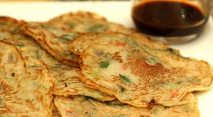 Vegan Korean Veggie Pancake. Kids will love this recipe and might even watch you make it. This colorful and flavorful dish is great for breakfast and lunch and can be enjoyed at picnics or Potlucks. Skip the chili flakes if you plan to enjoy it with little vegans.