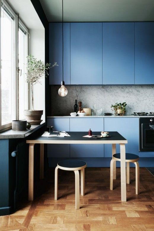 Beautiful blue kitchen featuring Alvar Aalto's design classic the Artek E60 Stool. Get the look at Utility: https://www.utilitydesign.co.uk/artek-60-stool