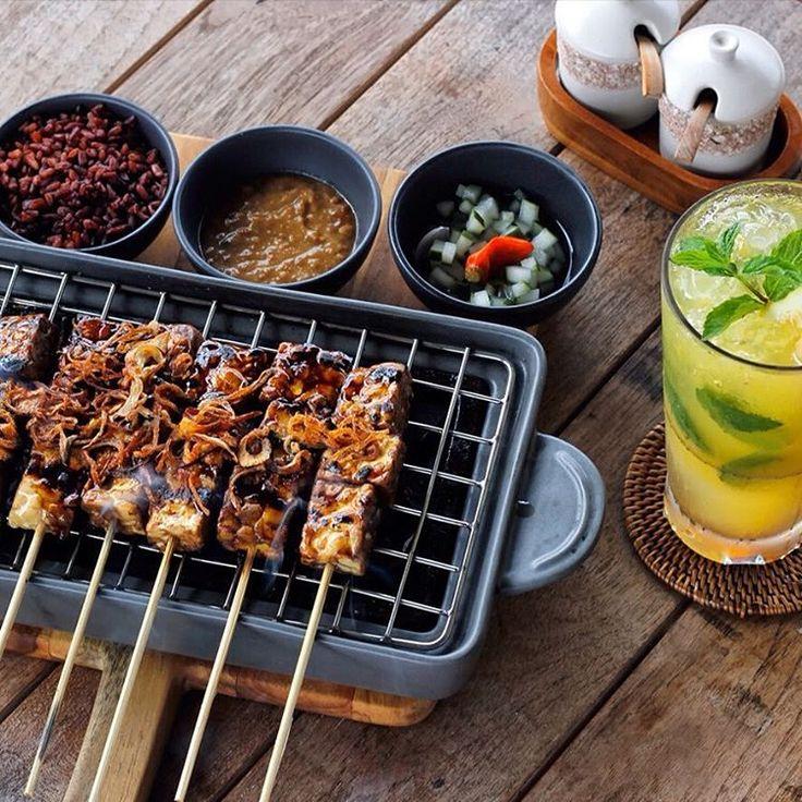 Charred Tempeh Satay served with Thai chili, scented rice, peanut sauce | Orange Fizz Honey – Vodka infused honey, orange juice, lemon juice, mint leaf, simple syrup. . . . . . #bismaeight #luxury #boutiquehotel #hotel #ubud #bali #besthotel #bestresort #lunch #satay #tempe #vodka #ubudhotel #balihotel #traveling #travel #instatravel #instatraveling #igtravel #travelgram #foodpics #foodie #foodies #onthetable #wtfoodies #foodism #foodporn #foodlover #foodhunt #foodphotography