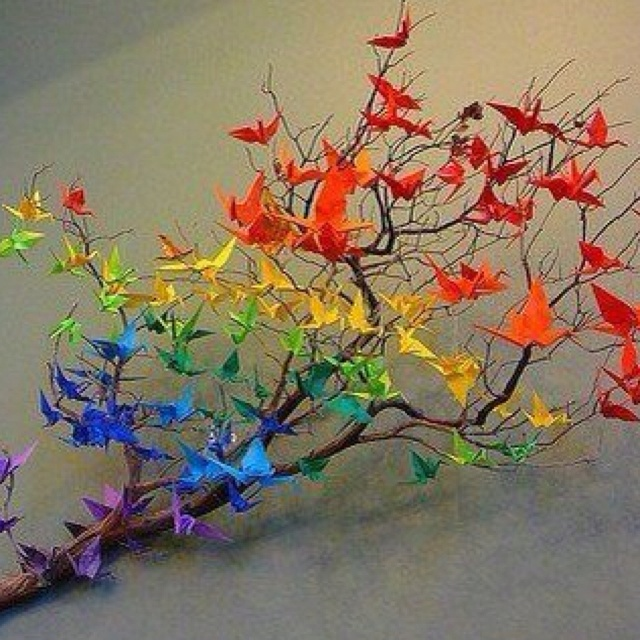 Rainbow Origami  paper cranes landed on a branch--red to purple