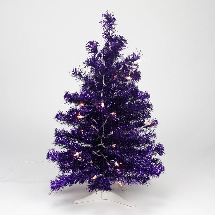 Buying Christmas trees online is more popular than ever.  It is convenient, easy and very affordable.  A great option for those with Pine allergies.  I love the look of artificial Christmas trees especially the pre-lit ones as they are the easiest.  I also love all the colors and types available from tinsel trees to more abstract #Christmas trees for Xmas 2017    Northlight Seasonal Pre-Lit Purple Iridescent Pine Artificial Tinsel Christmas Tree with Clear Lights, 2'