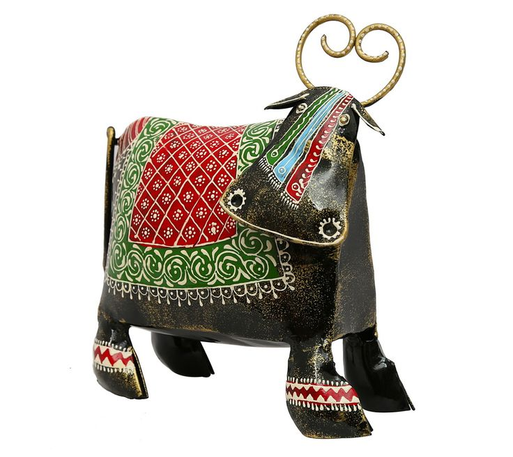 An elegant decorative Cow. Beautifully & intricately handpainted in catchy colours. Will add style yet give a contemporary look to your house. (There may be very MINOR VARIATIONS in color combinations and figure designs, between displayed and dispatched products, due to variety of artisans who handcraft the products. The look, feel and quality will , however, be consistent with what you see. That is an Indikala promise). .