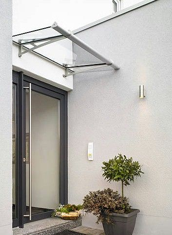 """Real Glass Safety Canopies - This new range of laminated safety glass door canopies keep all the benefits of the acrylic glass version, for instance the eye-catching design of the stainless steel arms, the simple to install """"Click-Lock"""" system and also the integrated aluminium rain gutter with drains on both sides."""