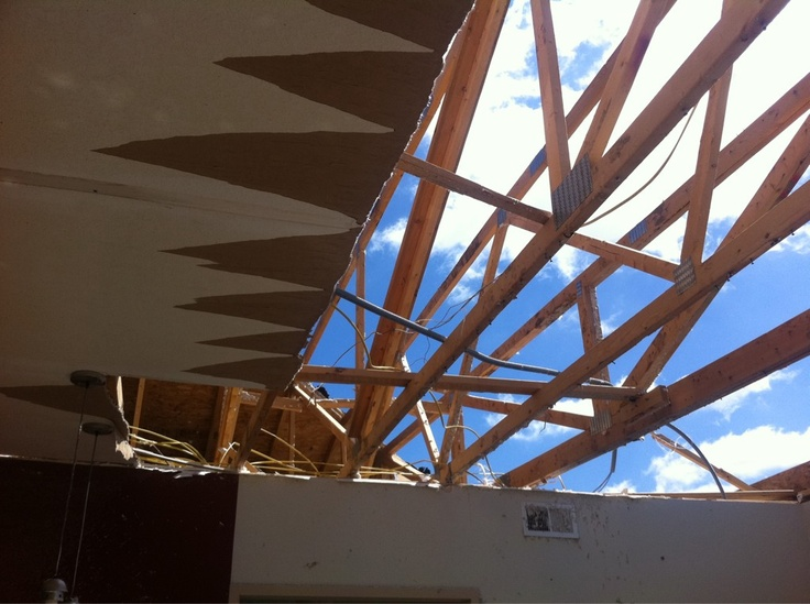 Lots of blue sky and ceiling beams poking out from dorms at Southwest Community College in Creston on Monday following Saturday's tornado.