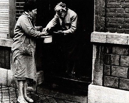 The mother of Georges Simenon on the doorstep of the house in the rue Pasteur, in Liège.