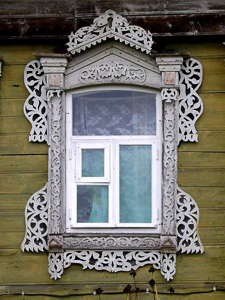 traditional decorative carved wood window frame, markovo, russia | architectural details