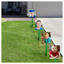 Graduation Walk - decorate for a graduation party with KODAK Picture Kiosk poster enlargements of the grad through the years.