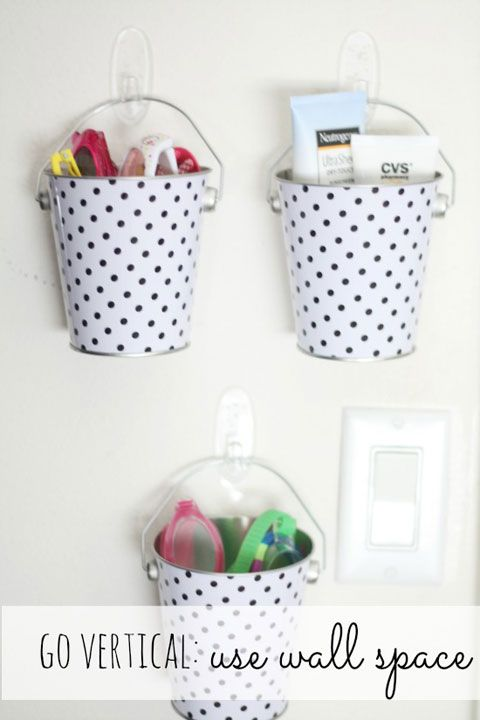 patterned metal buckets (from Target's dollar section) + clear Command hooks to…