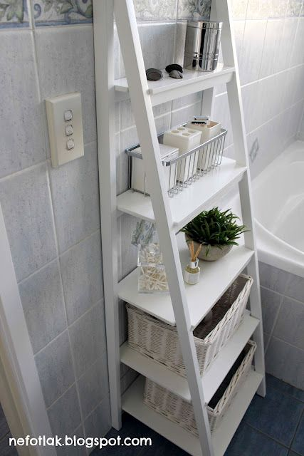I might take a World Market shelf and spray it white for more bathroom storage in one of the bathrooms.