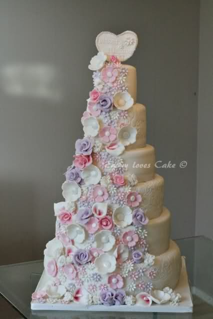 6 high wedding cake with waterfall of flowers