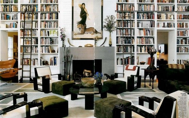tete a tete bookcase beside a fireplace
