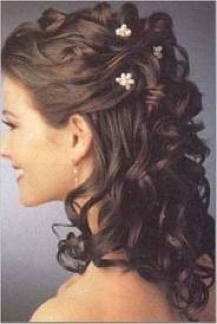 Half up half down curly wedding hair with flower brooches. Love.