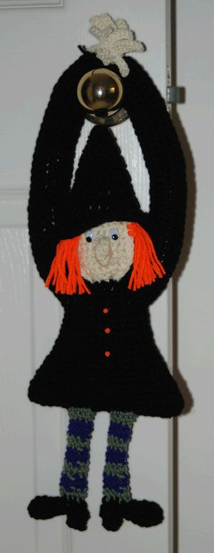Our adorable crochet witch isn't as scary as she is cute! Trimmed with orange yarn hair, oval shaped eyes and bulging nose, she's sure to capture your heart this Halloween. Her oversized hands and boots are comical but to complete the look she also boasts an A-framed dress, striped stockings and a large brimmed hat.