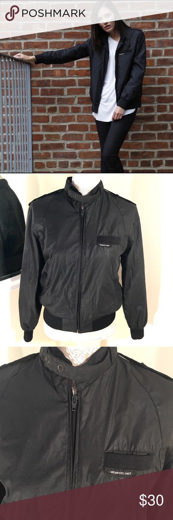 Members Only Iconic Jacket Classic iconic racer. A classic never goes out of style. Double snap iconic throat latch. Signature shoulder epaulettes and trademark front logo pocket. Polyester cotton blend . Good condition. Size is 34. Women's small. Black Jackets & Coats Utility Jackets