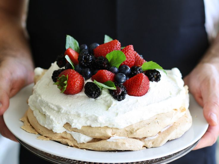 "Often called ""pav"" for short, pavlova is a baked meringue, crispy on the outside and marshmallowy on the inside, that is spread with whipped cream and topped with fresh fruit."