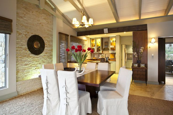 8 seater table, covered chairs, stone wall
