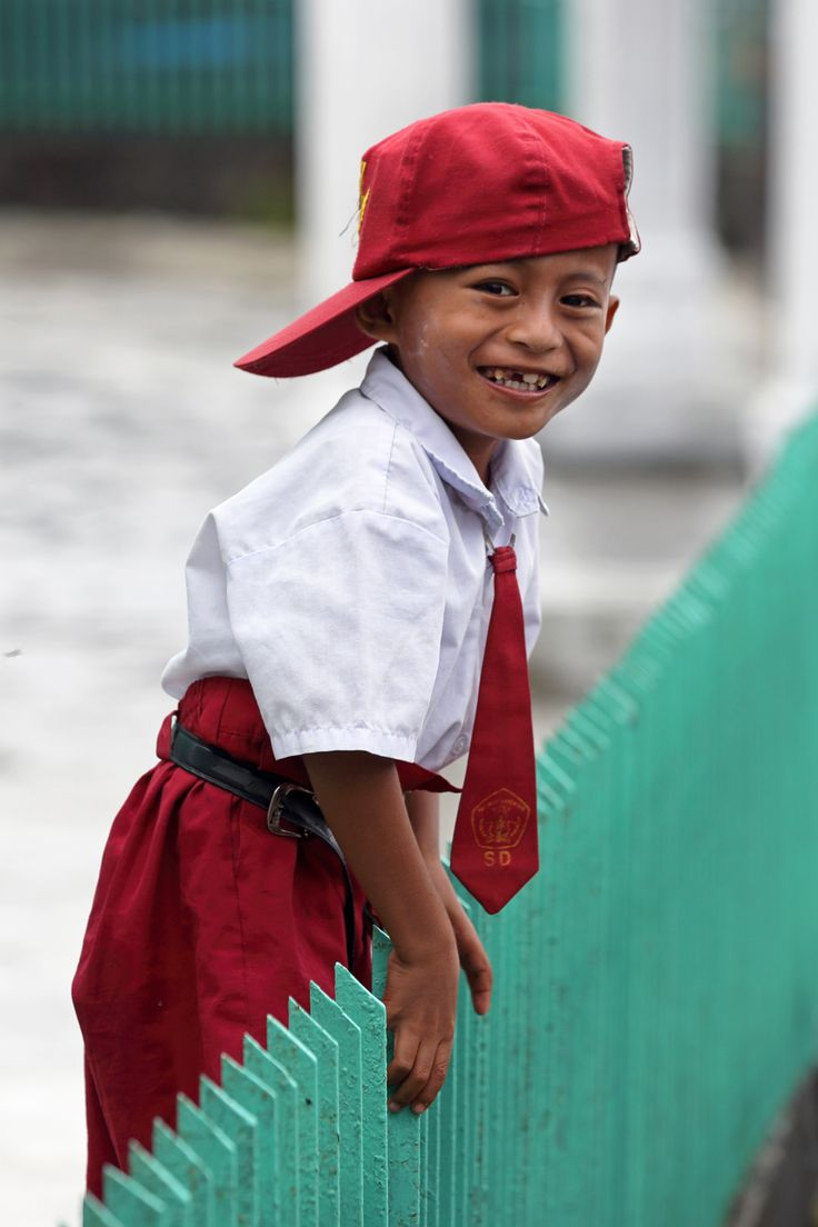 Cheeky school boy on Nias Island, Indonesia. Photos by Bjorn Svensson. www.visitniasisland.com