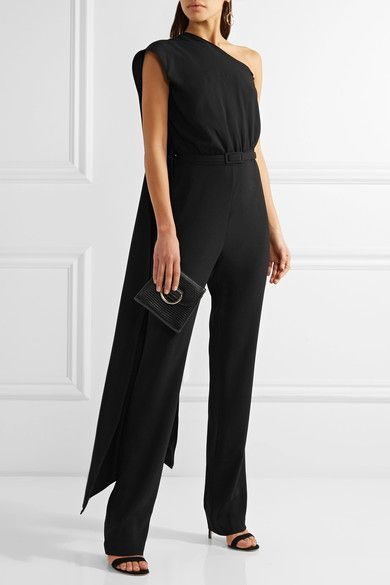 Co's jumpsuit is a chic choice for evening. Crafted from black Japanese crepe, it has a beautifully draped overlay that falls over one shoulder. This one-piece design has a detachable belt that cinches the waist and tailored straight-leg pants. Style yours with chandelier earrings and a sandals.