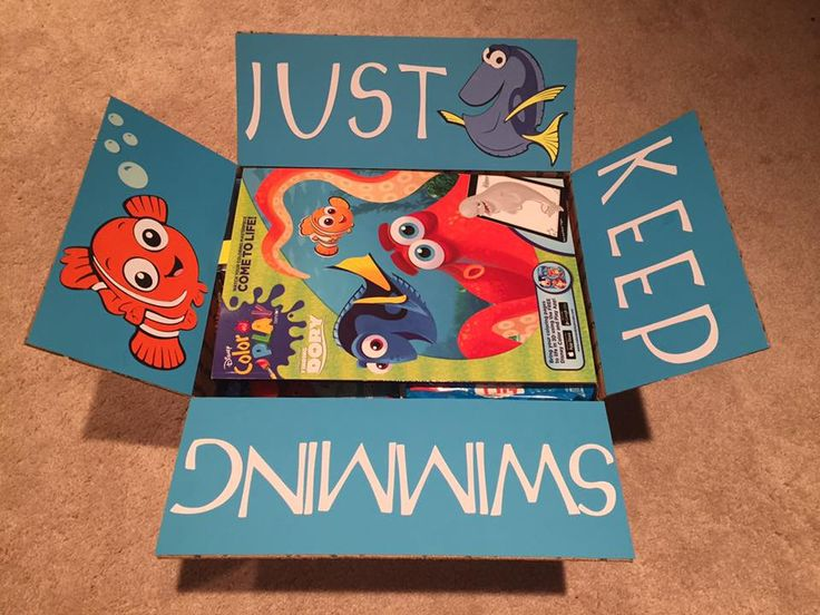 """""""Just Keep Swimming"""" Care Package for military or college - Finding Dory Care Package - Finding Nemo Care Package - medium flat rate box - filled with @Target $1 section items and snacks! Sent to Adopt a US Soldier/Project Front Lines.  Made by @Kristin Gayle"""