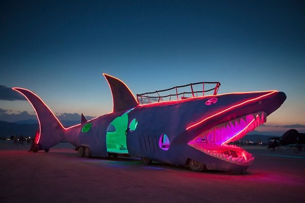 Burning man 2012 :The Shark Car  The Shark Car, a mutant vehicle built by a Seattle-based camp, made a welcome return to Burning Man after sitting out for several years.