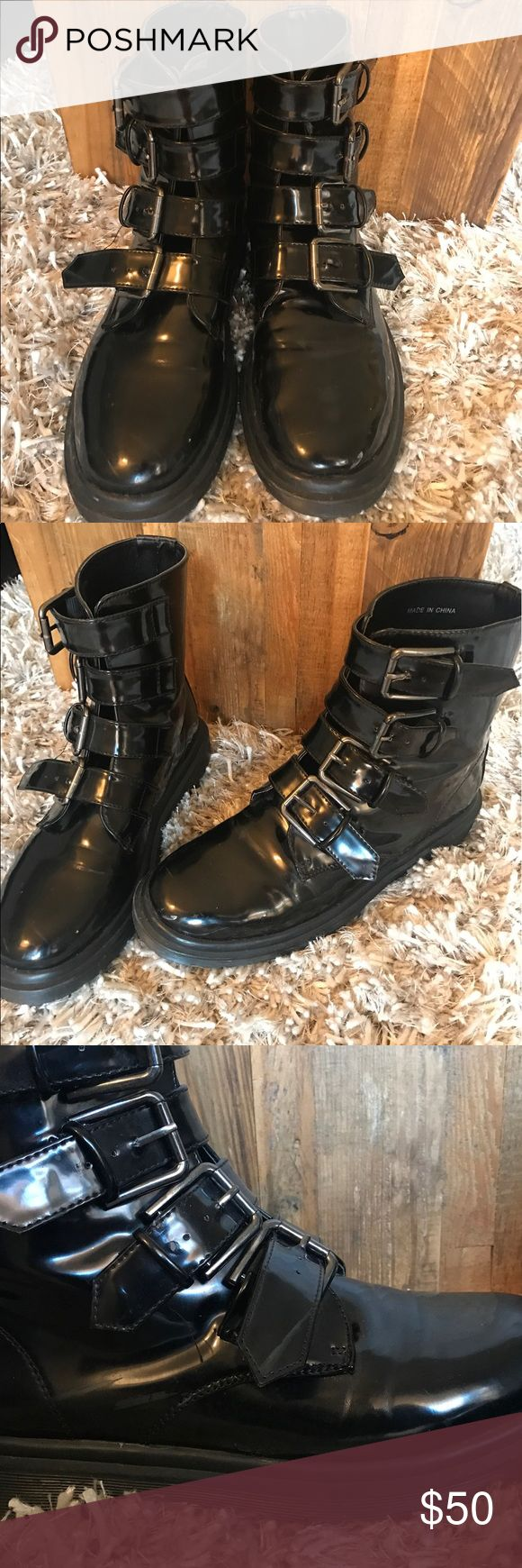 Black Combats Boots Deena & Ozzy- All black shiny combat boots.. in good condition! The third picture shoes a strap that has been broken on the bottom buckle. Other than that, they look new. Deena & Ozzy Shoes Combat & Moto Boots