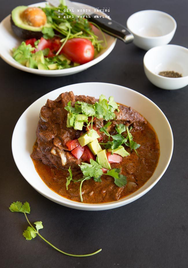 A slow cooker Chocolate Chicken Mole that is paleo and from the cookbook The Paleo Foodie.