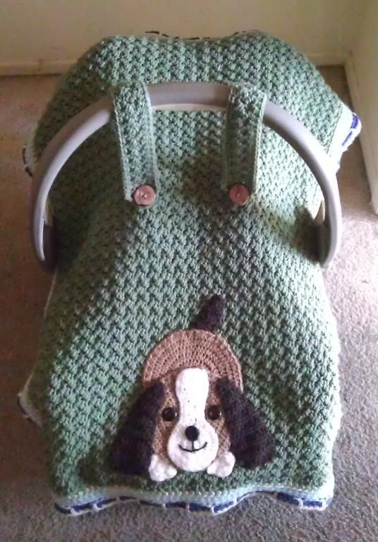 Crocheting: Playful Puppy Car Seat Canopy - This doggie applique is $2.  The car seat cover pattern is a free pattern (see Baby Stuff).  The person who made this put the two together.