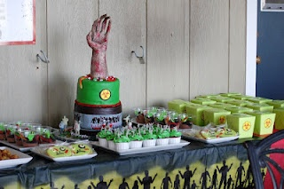 Zombie Table:  Bio Hazard cake, zombie cupcakes, zombie cookies, biohazard boxes with zombie bait (popcorn with green m's covered in green white chocolate, Grave yard pudding cups with zombie hands.  So much fun!