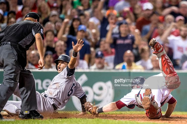 Mason Williams #66 of the New York Yankees is safe against the tag of Bryan Holaday #59 of the Boston Red Sox during the fourth inning of a game on September 18, 2016 at Fenway Park in Boston, Massachusetts.