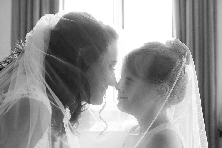 The Elvetham, Hampshire wedding | Bride & flower girl under veil