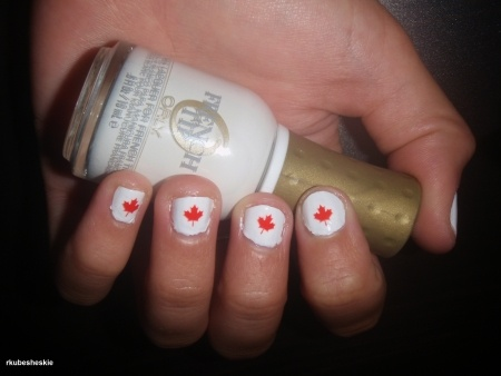 canada day nails - ORLY nail polish in White Tips with small red leafs that are cut up tattoos put on - sealed with a clear top coat