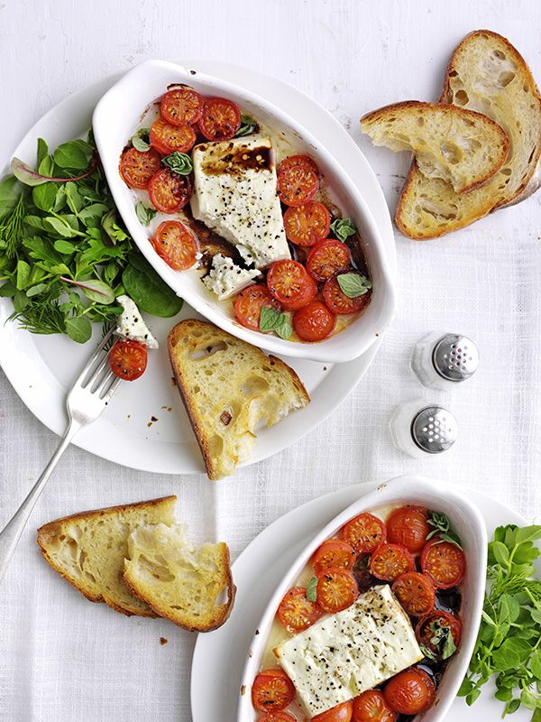 Baked feta with cherry tomatoes and garlic toast