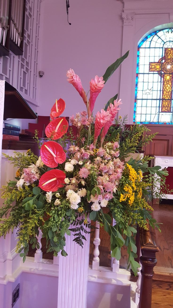 Summer arrangement of anthurium, pink ginger, protea