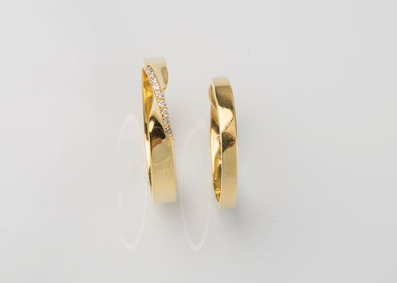 Beautiful handmade SOLID GOLD mobius ring set with natural diamonds. This sleek design looks great on everyone!  ***Perfect for trendy wedding band*** This mobius ring is set with 9 natural diamonds in micropave technique.  Details: The band measures 2.6mm width and 1.2mm thick. (This is our thinner mobius ring with 2.6mm width,while our medium is 3.5mm and the wider one is 4.5 mm) 9 diamonds 0.005ct (1.1mm) G colour VS clarity (conflict free) ***Black diamonds on request White gold,Rose…
