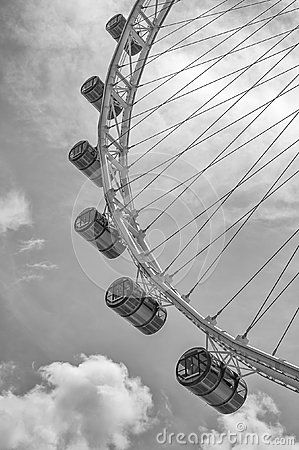 A dramatic rendition of the iconic Singapore Flyer, located in the Marina Bay waterfront of Singapore. The steel pylons of the structure are emphasized against a black and white canvas.