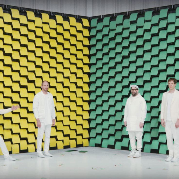 Kaleidoscopic visuals and choreographed printers feature in OK Go's new music video