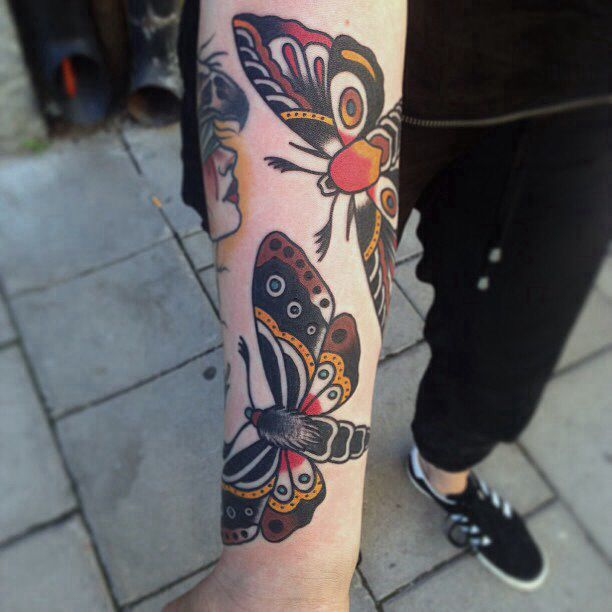Traditional moth tattoos