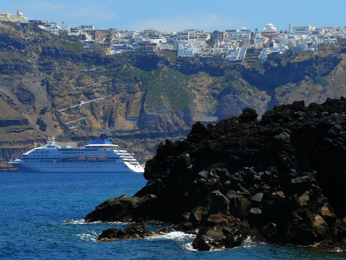 Santorini, Greece - a view from Nea Kameni Vulcano to Fira.  #travel, #destination, #Santorini, #Greece http://travellingwizards.com/destinations/countries/greece/islands/santorini