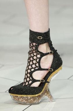 Alexandra McQueen cobweb sandals on a perspex sole
