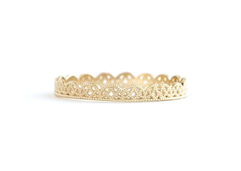 Go beyond a standard gold band for your wedding. These 17 options are perfect for the couple who want a special ring to match their personality. Here, the Grace Lee Petite Lace Band.