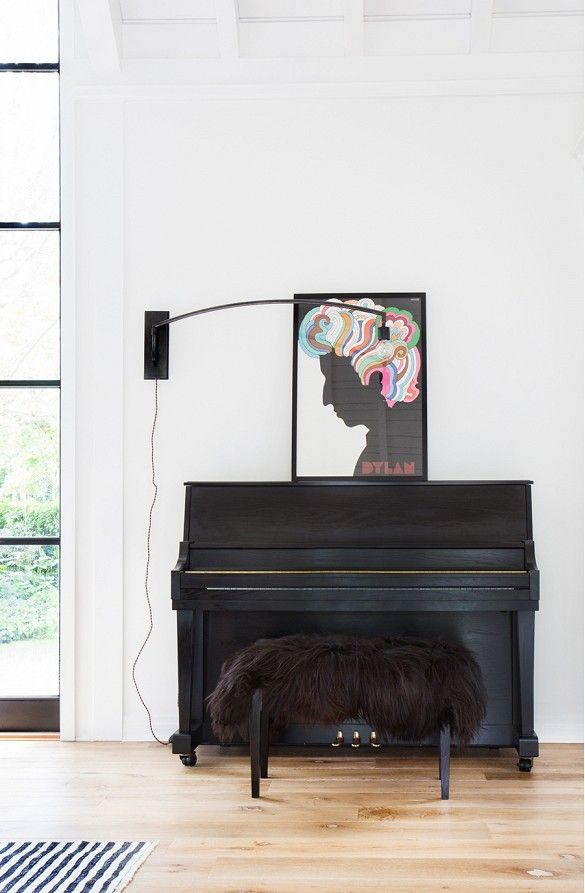 Afton, look at that sheep skin on the piano bench! Home Tour: A Crisp, Edgy, and Eclectic Family Home via @mydomaine