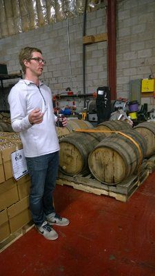 Duncan Clauss with some of the barrel aging beers | Yelp