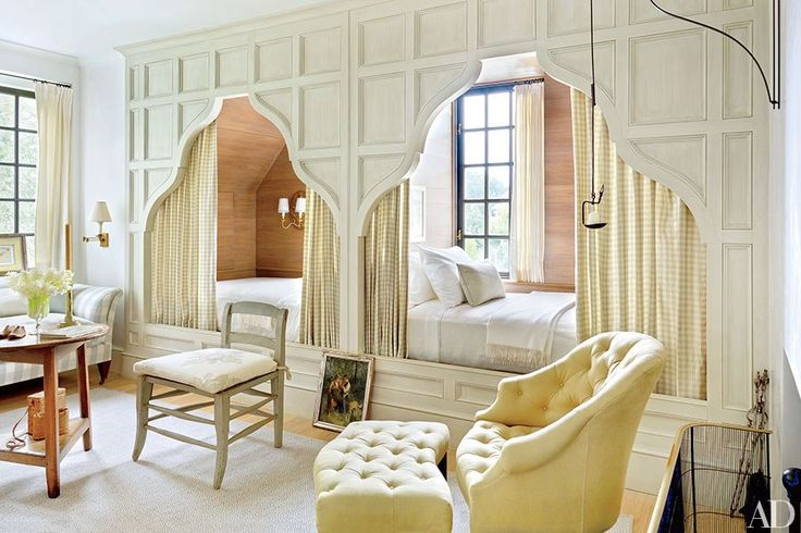 The guest room's custom-made box beds are accented with curtains of a Chelsea Editions check | archdigest.com