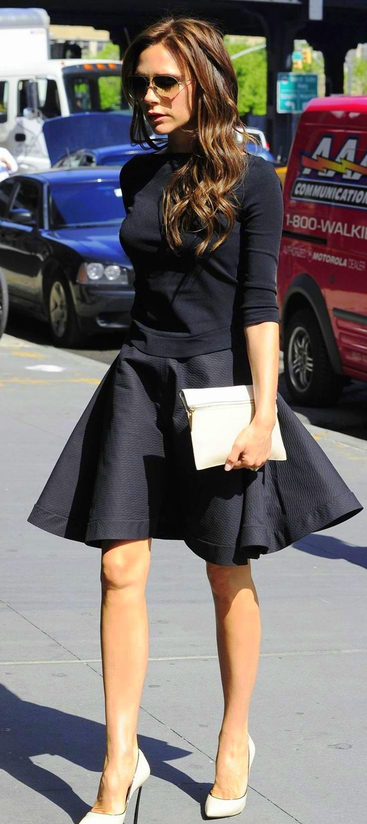 classic navy pullover classic navy skirt off while clutch and off white shoes.